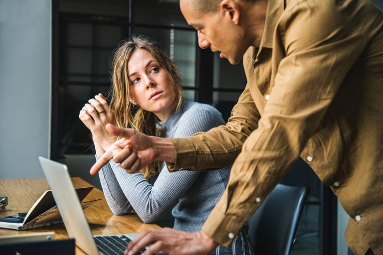 The pressures causing employees to act unethically in the workplace